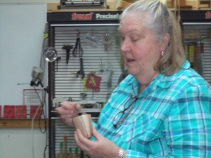 Kay shows off the box she won watching Bob Rosand